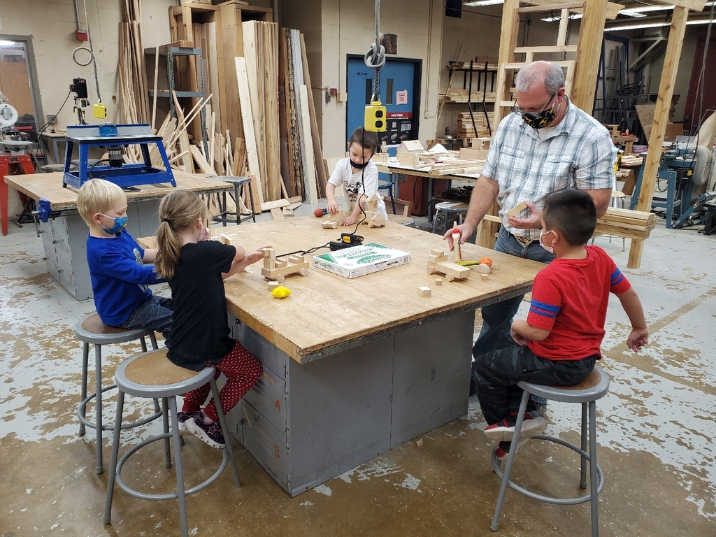 Kindergarten students working in a woodshop